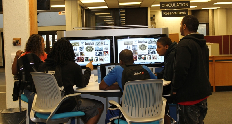 A group of ISU students tries out the Media:Scape workstation